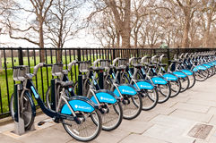 Rental Bikes. A row of rental bikes on the sidewalk outside Hyde Park royalty free stock photos