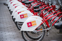 Rental bikes in antwerp. ANTWERP, BELGIUM - OCTOBER 2, 2016: With 1000 bicycles and 80 stations, Velo is among the largest bike sharing systems worldwide Stock Image