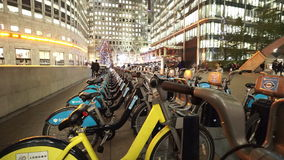 Rental bikes at Canary Wharf London stock footage