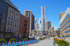 Rental bikes at Downtown Manhattan and Gehry tower- MANHATTAN - NEW YORK - APRIL 1, 2017 Royalty Free Stock Image