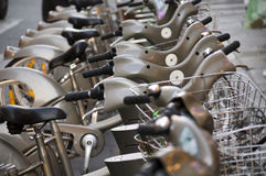 Rental bikes a go go. A row of rental bikes parked ready to be ridden Royalty Free Stock Photo