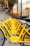 Rental bikes in a row. INDIANAPOLIS, INDIANA, USA - May 6, 2014: A row of rental bikes operated by Indiana Pacers Bikeshare and B-cycle, LLC Stock Photos