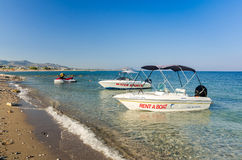 Rental boat on the beach in Kolymbia Stock Photos