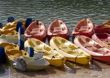 Rental boats chained together. Kayaks and paddle boats chained together waiting to be rented Royalty Free Stock Photography
