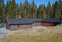 Rental cabins. In forested areas around Halden municipality are a number of great hiking and recreation areas. On the picture shows some small cottages set in a Royalty Free Stock Photo