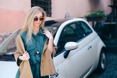 Rental car customer fyoung woman blonde hair driver lifestyle Stock Photo