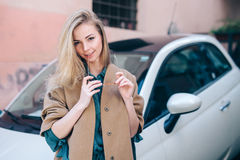 Rental car customer fyoung woman blonde hair driver Stock Photo