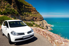 Rental car vacation. Scenic road viewpoint on vacation with rental car Royalty Free Stock Images