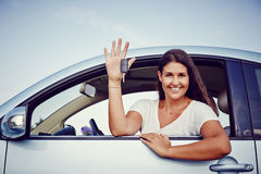 Rental Car Woman. Young woman smiling showing her new car keys, keys to her rental car Stock Photos