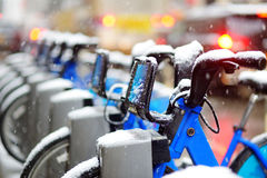 Rental city bikes covered with snow in New York Royalty Free Stock Photo