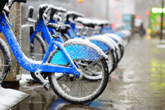 Rental city bikes covered with snow in New York Stock Photo