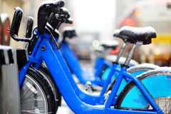 Rental city bikes covered with snow in New York Stock Photos
