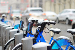 Rental city bikes covered with snow in New York Stock Photography