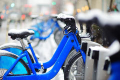Rental city bikes covered with snow in New York Royalty Free Stock Image