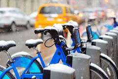 Rental city bikes covered with snow in New York Royalty Free Stock Photos