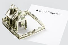 Rental contract and the money cut Royalty Free Stock Photos