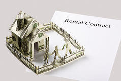 Rental contract and the money cut Royalty Free Stock Photo
