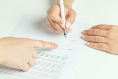 Rental contract signing. Woman signing the rental contract Stock Photography