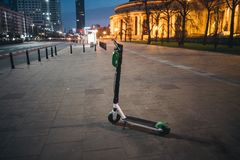 Rental electrical scooter. On Warsaw night street stock images