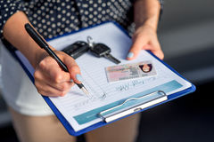 Rental inspector filling contract Stock Image