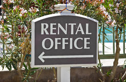 Rental Office Sign. Rental sign shows direction where the office is located at Stock Photography