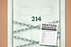 Renters insurance policy hanging from chains on apartment door representing security. Renters insurance policy hanging from chains crisscrossing and blocking Stock Image