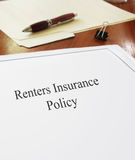 Renters Insurance Policy. On an office desk Royalty Free Stock Photos
