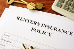 Renters insurance policy. Renters insurance policy on a table Stock Photography
