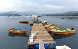 Renting Boats on Wooden Pier. In Hong Kong China royalty free stock image