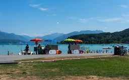 Renting stand for paddleboards and pedalos and Annecy lake view. 7 August 2018, Annecy France : renting stand for paddleboards and pedalos and Annecy lake view stock photo