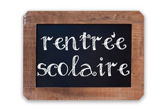 Rentree scolaire meaning Back to school written on a vintage blackboard with wooden frame isolated on white. Background Royalty Free Stock Image