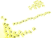 Reorganization. A concept image about reorganization, with word spelt out in letter blocks.  Taken on clean white background with copy space Stock Photos