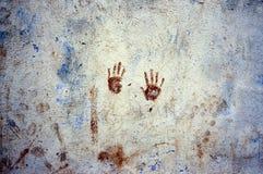 Repère des mains sur un mur Photographie stock