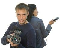 Repórter da tevê e teleoperator (foco na face) imagens de stock royalty free