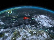 República Dominicana do espaço na noite Foto de Stock