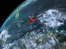 República Dominicana na terra do planeta no espaço na noite Fotos de Stock Royalty Free