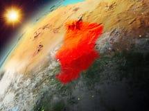 República eo Tchad en la tierra del planeta en puesta del sol Imagen de archivo