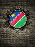 República velha da bandeira de Namíbia na parede de tijolo Fotos de Stock