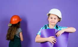 Repaint walls. Home improvement activity. Kids girls planning renovation. Violet is my favorite color. Children sisters. Renovation their room. Control royalty free stock photography