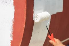 Repainting shell by roller brush Stock Images