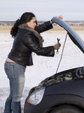 Repair. Woman with her broken car Stock Images