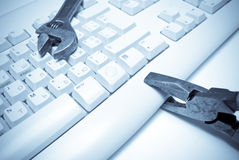 Repair. Pliers  and wrench on  keyboard Royalty Free Stock Photo