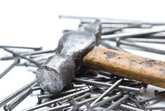 Repair. Hammer and nails on the white backgroun Stock Photography