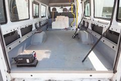 Repair and additional equipment of the truck car in the back of a van with a large luggage compartment during servicing with the stock photography