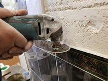 Repair - angle grinder or multi-tool royalty free stock image
