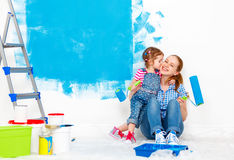 Repair in apartment. Happy family mother and child daughter pain Royalty Free Stock Photos