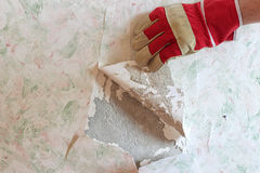Repair in the apartment. Removal of old wallpaper. Stock Photos