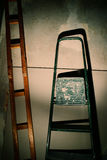 Repair in an apartment by using a stepladder Stock Photo