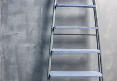 Repair in an apartment by using a stepladder Royalty Free Stock Photography