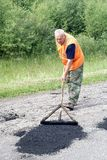 Repair of asphalt blade road Stock Photo
